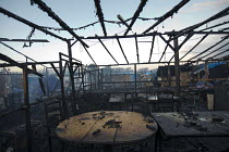 26-10-2016 - Kabul Cafe. Apocalyptic remains of the Calais Jungle refugee camp after fires rage during the eviction by French authorities, France. © Jess Hurd