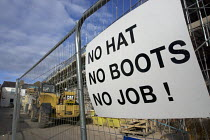 23-10-2016 - Health and safety notice at a building site entrance: No Hat, No Boots, No Job! Leamington Spa, Warwickshire © John Harris