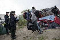 26-10-2016 - Refugees forced to leave the makeshift Jungle camp by riot police during the eviction. Calais, France. © Jess Hurd