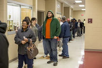 08-11-2016 - Detroit, Michigan, USA 2016 Presidential election Voters waiting in line for the 7:00am opening of the polling station © Jim West