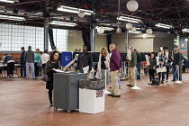 08-11-2016 - Michigan, USA 2016 Presidential election Voters place marked ballots in a counting machine at a Market © Jim West