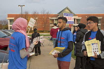 08-11-2016 - Michigan, USA 2016 Presidential election, American Arab & Muslim Political Action Committee (AAMPAC) campaigning for their candidates outside a polling station © Jim West