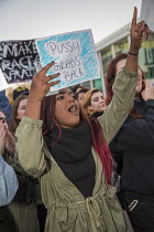 10-11-2016 - Detroit, USA, Students protest against the election of Donald Trump as U.S. President, Wayne State University. Pussy grabs back © Jim West