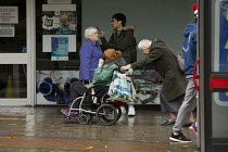 12-11-2016 - Elderly woman pushing a disabled woman in a wheelchair. Shoppers, Coventry Precinct © John Harris