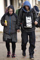 16-11-2016 - Stressed homeless couple holding hands, Leamington Spa, Warwickshire © John Harris