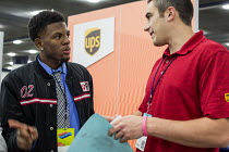 14-11-2016 - Detroit, Michigan: Young African American talking to a UPS recruiter, job fair sponsored by the nonprofit My Brother's Keeper © Jim West