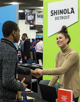 14-11-2016 - Detroit, Michigan: Young African American talking to a recruiter from Shinola, a maker of watches and leather goods, job fair sponsored by the nonprofit My Brother's Keeper © Jim West