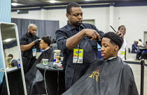 14-11-2016 - Detroit, Michigan: Young African American men having their hair cut, ob fair sponsored by the nonprofit My Brother's Keeper © Jim West