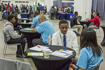 14-11-2016 - Detroit, Michigan. Young African American men practicing their interview skills at a job fair sponsored by the nonprofit My Brother's Keeper © Jim West