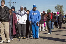 22-11-2016 - River Rouge, Detroit, Michigan, Hundreds of poor Americans wait in line for free turkeys and food parcels © Jim West