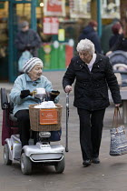 16-12-2016 - Elderly shoppers with shopmobility scooter Swindon Shopping precinct, Wiltshire © John Harris