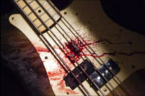 13-05-2016 - Bass guitar splattered in blood after a gig by heavy metal Doom band Conan, Leeds, Yorkshire © Connor Matheson
