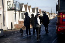 13-01-2017 - Jaywick youth wandering along the seafront under severe flood warning from a storm surge, Essex © Jess Hurd