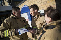 13-01-2017 - Firefighters organising leafletting local residents about the evacuation plan in Jaywick under severe flood warning from a storm surge. Essex © Jess Hurd