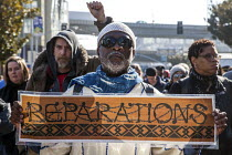 16-01-2017 - San Francisco, California, USA March celebrating the birthday of Rev. Martin Luther King Jr. Reparations refers to the demand that the USA make reparations to African Americans for 400 years of slaver... © David Bacon