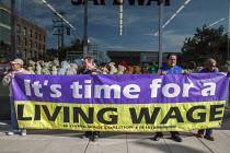 16-01-2017 - San Francisco, California, USA, March celebrating the birthday of Rev. Martin Luther King Jr. Time for a living wage banner of SF Living Wage Coalition © David Bacon