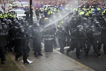 20-01-2017 - Riot police using CS gas. Anti Trump protests on Inauguration Day as Donald Trump takes office as President of USA, Washington DC © Jess Hurd
