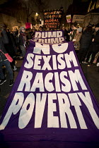 30-01-2017 - Thousands protest against American immigration ban and the invitation to President Donald Trump of a state visit, Westminster, LondonGlobal Women's Strike banner © Jess Hurd