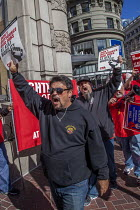 11-02-2017 - San Francisco, USA, workers at AT&T Mobility protest at the unwillingness of the company to agree a new union contract. Members of CWA in front of the AT&T Mobility office © David Bacon