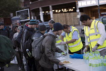 03-10-2016 - Homeless queuing for food handed out by the Imam Hasan Foodbank, Birmingham © Jess Hurd