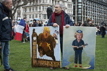 20-02-2017 - Artist Kaya Mar paintings of Donald Trump and of Theresa May One Day Without Us flag mob in support of migrants, Parliament Square, London © Philip Wolmuth