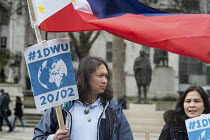 20-02-2017 - Filipino domestic workers, One Day Without Us flag mob in support of migrants, Parliament Square, London © Philip Wolmuth