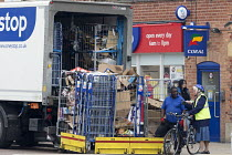 07-04-2017 - Driver collecting and loading rubbish in roll containers, One Stop convenience store, Stratford-upon-Avon, Warwickshire © John Harris