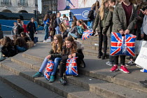16-03-2017 - French school pupils on a school trip resting, Piccadilly Circus, London © Philip Wolmuth