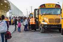 13-04-2017 - USA Mexican Border. Pupils from Palomas in Mexico Boarding buses in the morning to attend school in Columbus USA. All are US citizens, many living in Palomas with deported parents Others were born in... © Jim West