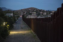 16-04-2017 - Nogales, Arizona, US Mexican border fence separatingNogales, Arizona (L) and Nogales, Sonora. Border Patrol lights illuminate the US side © Jim West