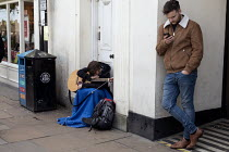 15-04-2017 - Homeless youth on the street busking, Stratford upon Avon, Warwickshire © John Harris
