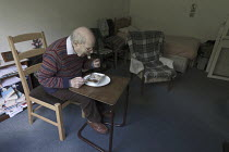 11-05-2017 - Pensioner in sheltered accommodation eating his meals on wheels lunch, Telford. Provided by a private company © John Harris