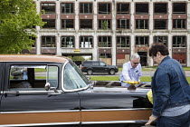 16-05-2017 - Detroit, Michigan USA Car enthusiasts polishing a 1956 Packard in front of the derelict factory where it was made. Peruvian developer Fernando Palazuelo has purchased the ruins of the Pakard plant at... © Jim West