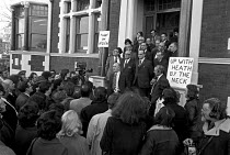 12-12-1972 - Hugh Scanlon, AUEW pres with the union executive behind him speaking to members after a large fine for contempt of court was imposed by the National Industrial Relations Court for ignoring its rulings... © NLA