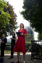 14-06-2017 - Grenfell Tower Fire. BBC TV News at One report led by Sophie Raworth as smoke still smoulders behind her a full 12 hours after the raging inferno that engulfed the West London tower block resulting in... © Stefano Cagnoni