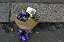 14-06-2017 - Grenfell Tower Fire. Flowers in memory of the victims laid amongst the ash that fell from the Grenfell Tower fire that engulfed the West London tower block overnight. The note reads Love and prayers t... © Stefano Cagnoni