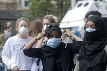 14-06-2017 - Grenfell Tower Fire. Residents from the local community don face masks to protect them from the smoke and fumes still in the air more than 12 hours after in the fire that engulfed the West London towe... © Stefano Cagnoni