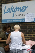 14-06-2017 - Grenfell Tower Fire. Local residents outside the Latymer Community Church Centre in West London just a few hundred metres from Grenfell Tower gather contributions from local people to help victims of... © Stefano Cagnoni