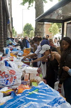 14-06-2017 - Grenfell Tower Fire. Local residents outside the Latymer Community Church Centre in West London just a few hundred metres from Grenfell Tower collect contributions donated by other local people to hel... © Stefano Cagnoni