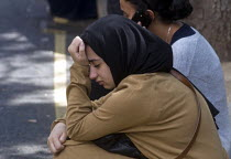 14-06-2017 - Grenfell Tower Fire. Young woman deeply upset and almost in tears waiting opposite the makeshift evacuation centre at Rugby Portobello Trust for news of victims of the fire that engulfed the West Lond... © Stefano Cagnoni
