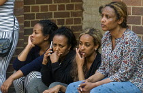 14-06-2017 - Grenfell Tower Fire. Anxious local women waiting opposite the makeshift evacuation centre at Rugby Portobello Trust for news of victims of the fire that engulfed the West London tower block overnight © Stefano Cagnoni