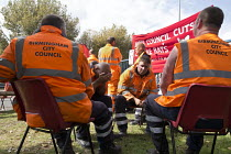 01-09-2017 - Worried workers discussing their future. Birmingham council refuse workers go on strike against redundancies, Perry Barr Depot, Birmingham. Birmingham City Council want to save 600,000 a year by axing... © John Harris