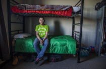05-04-2017 - Washington, USA H2A contract worker in the room he shares with three other workers. Tempory migrant workers are brought into the USA by growers under the H2A visa program. Workers live in the barracks... © David Bacon