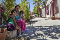 15-08-2017 - Coachella Valley, California, USA Maria Pozar, her daughter Jacqueline and baby Leslie, North Shore, near the receeding waters of the Salton Sea. Jacqueline suffers nose bleeds when the dust blows fro... © David Bacon