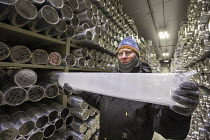 28-08-2017 - Denver, Colorado, USA National Ice Core Laboratory curator Geoff Hargreaves holding a one meter section ice core stored at -36 degrees C. The Laboratory stores 19,000 meters of ice cores from Antarcti... © Jim West