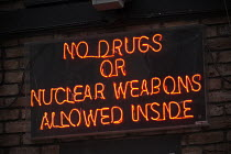 25-09-2017 - No Drugs or Nuclear Weapons Allowed Inside neon sign outside a bar, Brighton © John Harris