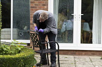 27-09-2017 - Forensic scene of crime investigator dusting for fingerprints and searching for clues after an attempted break in to a house, Warwickshire. The burglars were disturbed whilst smashing double glazed wi... © John Harris
