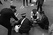 15-06-1974 - St Johns Ambulance men treating Kevin Gately who died from a fatal injury to the head, 1974 Red Lion Square confrontation between police and demonstrators who were trying to stop the National Front fr... © NLA