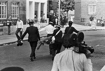 15-06-1974 - St Johns Ambulance men taking Kevin Gately to hospital, he died from a fatal injury to the head, 1974 Red Lion Square confrontation between police and demonstrators who were trying to stop the Nationa... © NLA