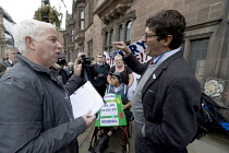 10-10-2017 - Parents of children with disabilities lobbying Coventry Labour Council against cuts to, and charges for, school transport, Coventry. Lcbour Councillor Kevin Maton arguing with a protestor. The Council... © John Harris